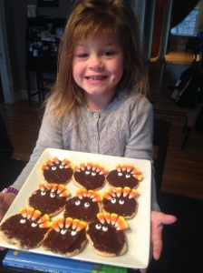 Annabelle getting ready to celebrate Thanksgiving this year in America, 2014! So proud of the cookies she made!